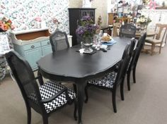 SOLD - French Provincial style dining table with 3 leaves and 6 chairs. Painted black and distressed.  ***** In Booth H13 at Main Street Antique Mall 7260 E Main St (east of Power RD on MAIN STREET) Mesa Az 85207 **** Open 7 days a week 10:00AM-5:30PM **** Call for more information 480 924 1122 **** We Accept cash, debit, VISA, Mastercard, Discover or American Express