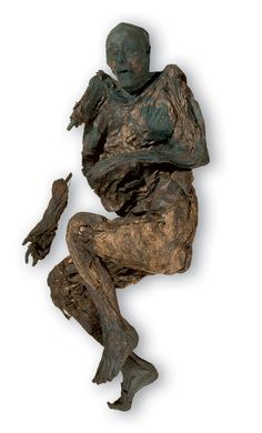 The Huldremose woman, 2nd century BC. Found in a peat turf at Huldremose in Denmark. She wore a skirt of wool, a scarf and two skin capes. The woman was more than 40 years old when she ended up in the bog. She was an old woman by Iron Age standards of life expectancy.