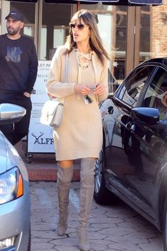 Alessandra Ambrosio wearing Celine Box Bag, Stuart Weitzman Highland Suede Boots in Topo and Maeve Lace-Up Sweater Dress