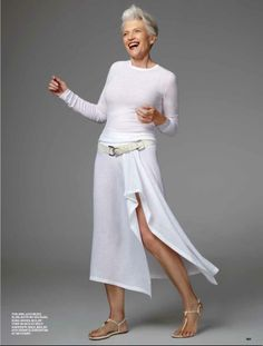 A tasteful way for a woman over 50 to wear a skirt with a slit