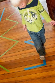 stick tape on floor, let kids follow or blow pompoms along the lines.