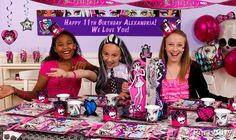 A custom Monster High birthday party banner, balloon bouquet and streamers behind your party table make a perfect setting for freaky-fabulous party photos!
