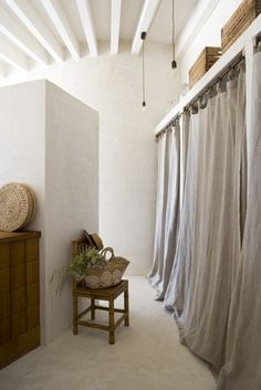 raw linen cloth curtains are beautiful many places, here they replace doors.