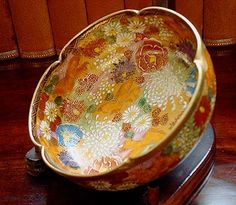"A 19th Century Japanese Satsuma Hand decorated ""Pinched"" Small Bowl with Floral and Gilt Decoration. Finely Executed and Signed."