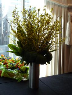 An arrangement of yellow forsythia branches.  See our entire selection at www.starflor.com.  To purchase any of our floral selections, as gifts or décor, please call us at 800.520.8999 or visit our e-commerce portal at www.Starbrightnyc.com. This composition of flowers is generally available for same day delivery in New York City (NYC). MA049