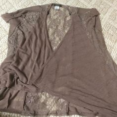 Size Large sweater overlay. Short sleeve lace overlay. Brown/purple in color. With lace on the back and on the sides Deb Tops