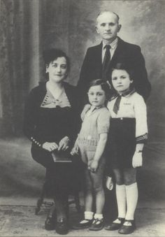 Family photo taken in Paris, France 1942 of 7 year old Bernard Lerer standing beside his older sister and in front of his father. The family was murdered in Auschwitz on Aug. 23,1942.