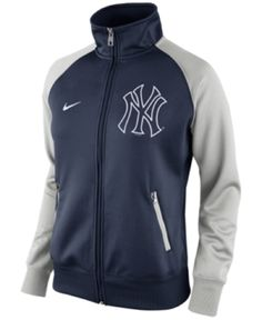 Nike Womens New York Yankees Raglan MLB 1.5 Track Jacket Blue/Grey MEDIUM 00031297XYN1 (X-Large). Authentic Nike. MLB Officially Licensed. Full Zipper. 100% Polyester. Imported.