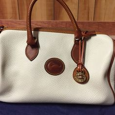 Cream and tan brown leather satchel Small and well cared leather satchel, zipper closure, phone pocket. In new condition, no scratches, scoffs and dust bag included Dooney & Bourke Bags Satchels