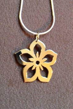 Hand pierced 22 karat and sterling silver Cherry Blossom necklace.