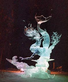 Ice sculpture mermaid ♥ I want two. One of the groom and one of the bride. But together? You know?