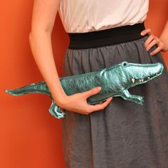 Shimmery alligator clutch. Accessorizing with a punch.