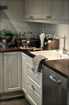 Kitchen-love the white matte subway tile with the dark butcher block bench top