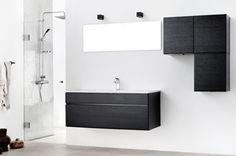 De sorte, håndtaksløse Mano Sera-dørene er enkle og tidløse. Benkeplate og designvask med bunnplate er støpt i ett og gir en flott finish.