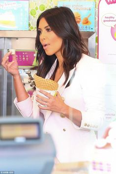 Splitting opinion! Kim Kardashian flouts fashion rules and shows off her cleavage AND legs as she heads out for frozen yoghurt.