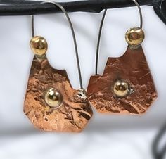 On my Etsy shop : Hammered Copper and Brass Earrings - Boho Copper Earrings https://www.etsy.com/listing/498265744/hammered-copper-and-brass-earrings-boho?utm_campaign=crowdfire&utm_content=crowdfire&utm_medium=social&utm_source=pinterest
