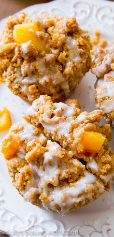 The best peach muffins. Seriously! Buttery, tender, moist, and heavy on the crumb topping and sweet vanilla glaze.