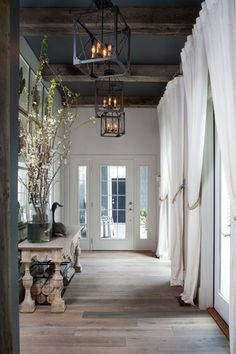 Rustic Entryway with French doors, Exposed beam, Chandelier, Hardwood floors