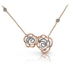 ZP609- This delicate 14K rose gold floral pendant depicts a rose garden with its flowing designs and contains .41ctw of white diamonds and is a part of our Nature Lover Collection.