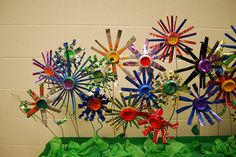 Recycled flowers, so pretty... could decorate window ledges in classrooms (idea from paintedpaper)