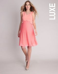 Seraphine's signature pleated maternity dress is a smart style in a fresh coral shade - perfect for before, during and after pregnancy. The fitted Ponte Roma bodice meets the skirt with a stylish belted peplum, designed to define your empire waist. The soft woven skirt falls in elegant pleats into a form flattering A line shape. Classically chic, this is one of those invaluable maternity dresses, perfect for a day at the office or any smart occasion. #afterpregnancybelt,