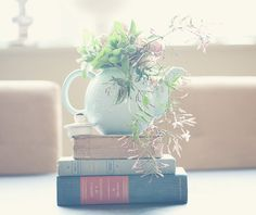 Centerpieces consisting of flowers in teapots on books. Will be raiding vintage and thrift stores for this shindig.