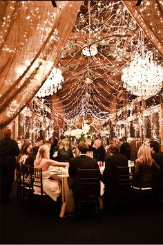 Transform a barn into a glamorous ballroom with light strands and chandeliers.