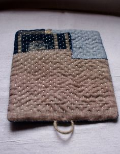 hand sewn table mat, trivet, pot holder in linen, patched with kasuri cottons
