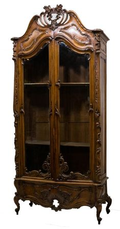Rococo Revival Carved Walnut Bookcase Cabinet, circa 1890.