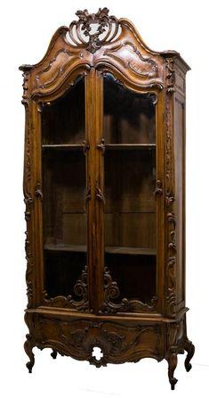 Rococo Revival Carved Walnut Bookcase Cabinet, circa 1890.