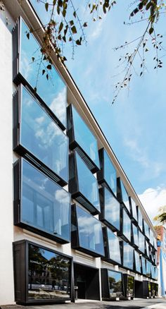 ceiling-high window casements that mounted in front of the façade at a slight angle towards the plane of the façade http://www.archdaily.com/393506/karmeliterhof-love-architecture-and-urbanism/