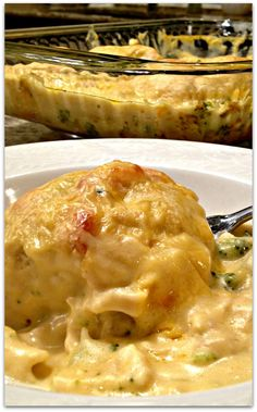 CHEESY CHICKEN CRESCENT BAKE - Crescent rolls stuffed with rotisserie chicken, broccoli and cheddar cheese, baked, then smothered in a cheesy sauce....and baked again. Absolutely delicious!   SweetLittleBluebird.com