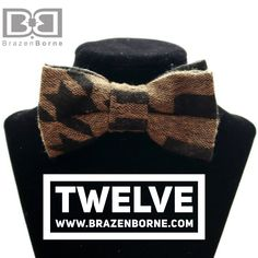Wool houndstooth bow tie with adjustable strap.