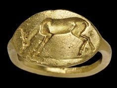 A GREEK GOLD FINGER RING  CLASSICAL PERIOD, CIRCA 4TH CENTURY B.C.  Stirrup-shaped, the plain hoop flat on the interior, rounded on the exterior, the pointed oval bezel bevelled on the underside, the upper surface engraved with a grazing deer on a short groundline 13/16 in. (2.1 cm.) wide; ring size 5½  http://www.christies.com/lotfinder/lot/a-greek-gold-finger-ring-classical-period-4821650-details.aspx?from=searchresults&pos=3&intObjectID=4821650&sid=67afd749-ce87-455a-9ec0-315c05bc04f2&pag