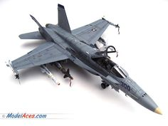 """Professionally built 1/32 scale model airplane of a McDonnell Douglas / Boeing F/A-18C Hornet """"Ragin' Bulls""""."""