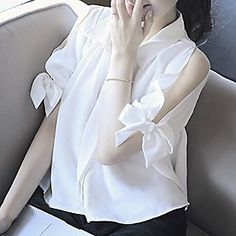 Buy Reis Cutout Shoulder Bow Blouse at YesStyle.com! Quality products at remarkable prices. FREE WORLDWIDE SHIPPING on orders over US$ 35.