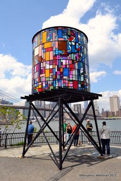 This watertower was constructed using nearly one thousand scraps of colorful Plexiglas and steel. A tribute to the 'iconic New York water tower and a symbol of the vibrancy of Brooklyn', Fruin worked with salvaged and discarded materials recovered from all over New York City to create the mas... #Glass
