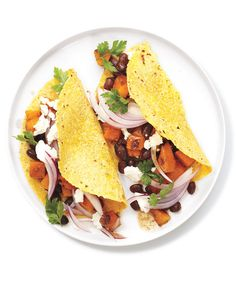 This nutrient-dense taco is filled with an unexpected combination of ingredients, but butternut squash and black beans pair surprisingly well together. The rich, earthy flavors of the combo are offset by the zesty bite of the red onions and the creamy goat cheese.