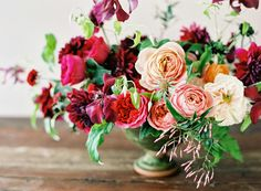 Lush garden rose, dahlia, clematis and vine centerpiece by Sarah WInward, photo by Leo Patrone