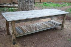 $2 Farmhouse Table!  Resourcefully constructed using leftover decking material, 2x4's, and wooden pallets. This would be a great potting table for your garden projects. | Do It Yourself Home Projects from Ana White