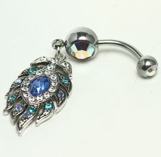 blue feather belly ring.