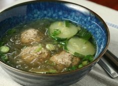 pork meatballs in a clear light soup with cucumbers, cilantro and glass noodles