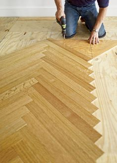 Continue the pattern until the point of the chevron reaches the border. Unscrew the blank, reverse it, and place it against the tongue of the last slat laid, flush with its end. Screw it to the subfloor, as shown.