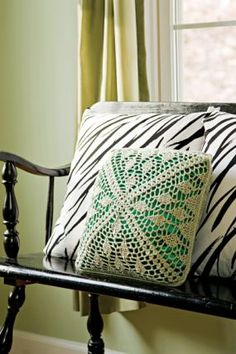 Add a touch of style to your living space with this pretty crochet pillow.