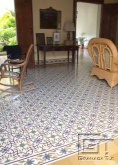 Ornate Graphic Cement Tile Pattern Forms Elegant Carpet
