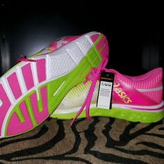 Asics Neon running shoes!!! Neon running/working out/ shoes. Never worn! Too big for me. Says size 10. Fits  slightly like 91/2. Asics list as gell comfort  with continental rubber outsole for enhanced performance on any terrain!  And fashionable! asics Shoes Sneakers
