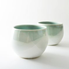 "sold as a set of 2. each tumbler has it's own unique markings, and shapes vary slightly. approx 3.5"" wide, 4"" high. glazed glassy blue and white.food/dishwasher safe.all items in this store are made in the wabi sabi tradition. crazing, crackling, and other irregular textures and surfaces are part of the handmade nature, and should be embraced."