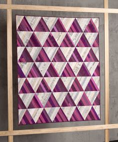 This beauty is an improv spin on a very traditional onepatch quilt. If you look closely you will notice that each triangle is made up of s...