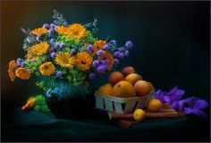 still life of flowers and fruit.  the caption says marigolds, but there are none in it that I can see.  My tired brain won't name the orange ones though.  looks like chive and dill flowers with babies breath other than that.  From Pixdaus.com