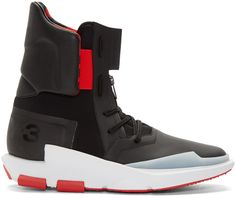 High-top textile and leather sneakers in 'core' black and 'flame' red featuring alternating coated textile, mesh, and leather textures throughout. Round toe. Tonal lace-up closure. Zippered expansion panel and logo flag at tongue. Elasticized bands in red at sides of tongue. Padded collar. Logo in red and black at inner collar. Buffed leather heel tab. Logo printed at heel. Sculpted rubber sole colorblocked in white and red. Tonal stitching.
